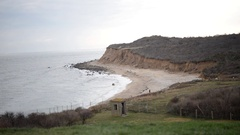 Dunes and cliffs off Montauk Point as waves reach the shore Stock Footage