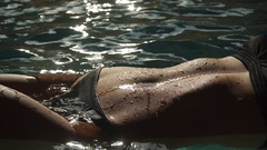 Young sexy attractive woman in the water, close up on body curves. Beauty Stock Footage