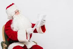 Santa Claus Reading Letter isolated over white baclground Stock Photos