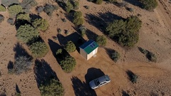 Aerial orbit of a tiny house in the desert Stock Footage