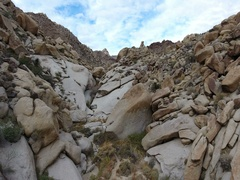Aerial pullback of a rugged rocky canyon in the desert Stock Footage