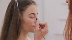 Close up shot. Professional make-up artist applying eyeshadow Stock Footage