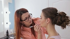 Professional make-up artist applying lips contour Stock Footage