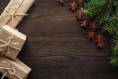Christmas composition on wooden background with tree, pine cones, star anise and Stock Photos
