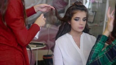 Hairstylist making hair-do slow motion Stock Footage