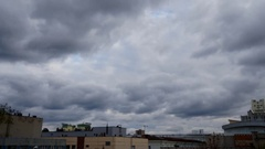 Old industrial city roofs with massive greey clouds timelaps Stock Footage