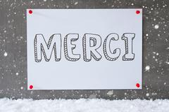 Label On Cement Wall, Snowflakes, Merci Means Thank You Stock Photos