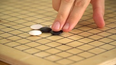 Chinese go game weiqi playing on wooden board Stock Footage