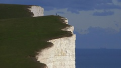 Personal accomplishment - jogger atop White Cliffs of Dover, England Stock Footage