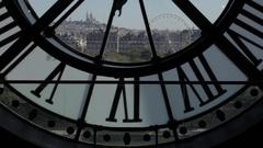 Iconic Paris cityscape - establishing shot through clock face Stock Footage