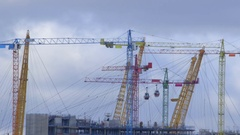 Construction crane frenzy with passing cable cars - time lapse Arkistovideo