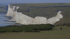 Girl walks, treks alone on moors of White Cliffs of Dover, England UK Stock Footage