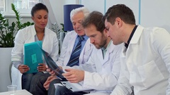 Medical team discusses x-ray image Stock Footage