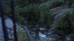 View out train window crossing mountain stream, French Pyrenees Stock Footage