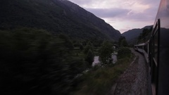 View out window of Europe night sleeper train, dusk falls, Pyrenees Stock Footage
