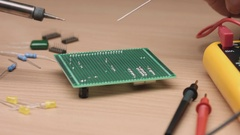 Soldering chip to board with iron Stock Footage