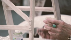 Hand painter paints a chair in the Provence style Stock Footage