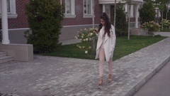Young sexy successful woman walking down the street using her smartphone Stock Footage