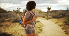 Cute African woman hiking Joshua Tree, National Park, on hike in Mojave Desert. Stock Footage