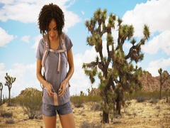 Attractive black woman on a hike in Joshua Tree, National Park. Stock Footage