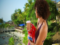Attractive young woman looking at beach from caribbean resort. Stock Footage