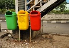 Group of colourfull trash box in side street Stock Photos