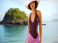 Happy black woman standing on caribbean beach. Stock Footage
