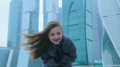 Girl posing against the backdrop of a skyscraper Stock Footage