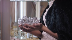 Woman chooses bridal accessories in wedding boutique and wear crown with Stock Footage
