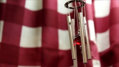 Red windchimes dancing in kitchen Stock Footage