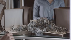 Shop assistant helps the bride in choosing bridal diadem at shop on wedding Stock Footage