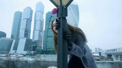 Beautiful woman at lamppost Stock Footage