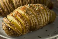Homemade Cheesy Hasselback Potato Stock Photos