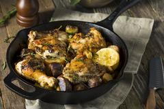 Homemade Baked Chicken in a Skillet Stock Photos