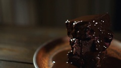 Chef put cherry on brownie chocolate cake. Homemade cake. Delicious dessert Stock Footage