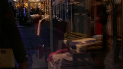 Reflection of crowd of people shopping cloths on the window of a shop store Stock Footage