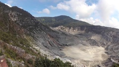 Panning view of Tangkuban Perahu Crater in daylight Stock Footage