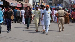 Indian people in a street during traffic near Golden Temple, Amritsar. India Stock Footage