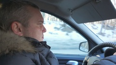 Man drives a car. Close-up profile. Men inside his car, driving on a Winter d Stock Footage