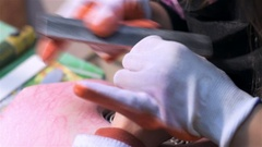 Young nail technicians accepting client. Close up Stock Footage