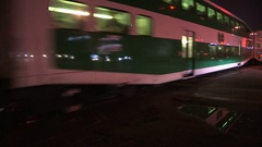 GO transit commuter train in Toronto during evening rush hour commute Stock Footage