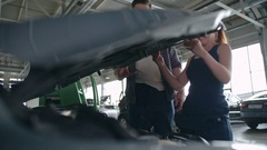 Mechanics Working Together Stock Footage