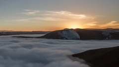 Clouds over volcano Mount Elbrus in the autumn at sunset Stock Footage