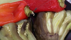 Roasted vegetables - eggplant and pepper with tomato salsa , close up Stock Footage
