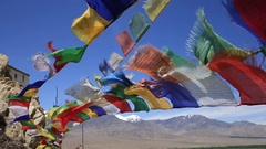 Colorful Buddhist prayer flags at Thiksey monastery. Leh, Ladakh, India Stock Footage