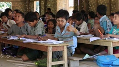 Burmese girls and boys in a local school during the lesson. Myanmar, Burma Stock Footage