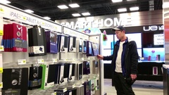 Motion of people buying ipad cover inside Best buy store with 4k resolution Stock Footage