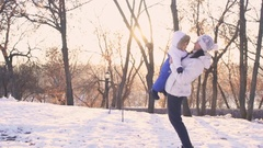 Beautiful happy young Family having fun outdoors at winter. Stock Footage