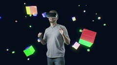 Man with VR gear glasses within interactive space touch virtual cubes Stock Footage
