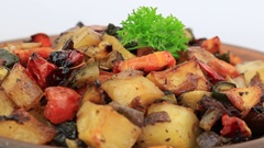 Vegetable stew with tomato, eggplant, zucchini, onion, carrot, pepper, potato Stock Footage